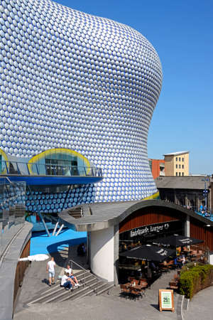 View of the Selfridges building in the Bullring with people enjoying the sunshine, Birmingham, England, UK, Western Europe.