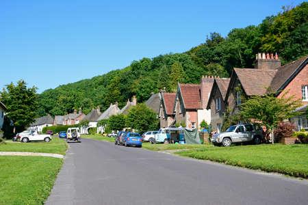Pretty cottages along the main village street, Milton Abbas, Dorset, England, UK, Western Europe.