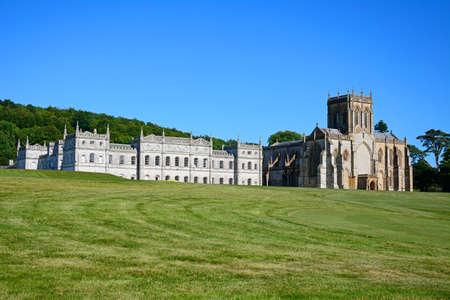 british weather: View of Milton Abbey church and school, Milton Abbas, Dorset, England, UK, Western Europe.