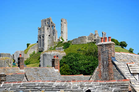 11th: View of Corfe castle on the hilltop, Corfe, Dorset, England, UK, Western Europe. Stock Photo
