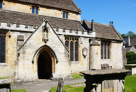 View of St Andrews church in the village centre, Castle Combe, Wiltshire, England, UK, Western Europe. Stock Photo