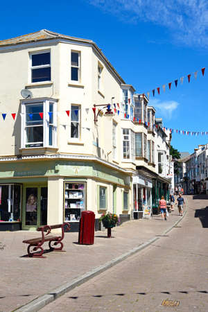 town centre: View along a town centre shopping street, Seaton, Devon, England, UK, Western Europe.