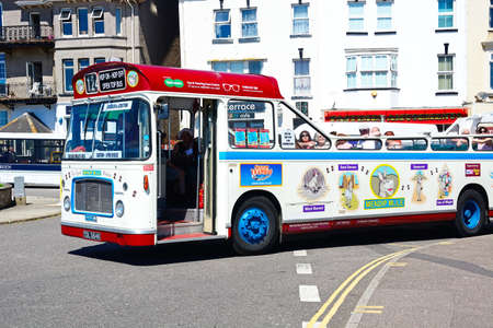 tour bus: Bristol RE tour bus along a town centre shopping street, Seaton, Devon, England, UK, Western Europe.