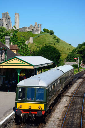 br: BR Class 108 diesel train in the railway station with the castle to the rear, Corfe, Dorset, England, UK, Western Europe.