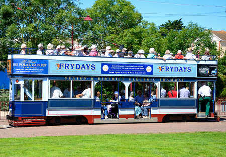 holidaymaker: View of an open topped Seaton Electric Tramway Tram packed with tourists, Seaton, Devon, England, UK, Western Europe.