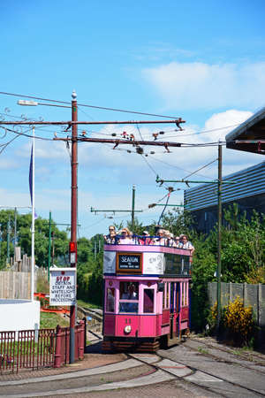 View of an open topped Seaton Electric Tramway Tram packed with tourists, Seaton, Devon, England, UK, Western Europe.