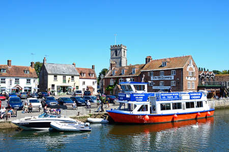 piddle: Boats on the river with views towards The Old Granary and Lady St Mary church, Wareham, Dorset, England, UK, Western Europe.