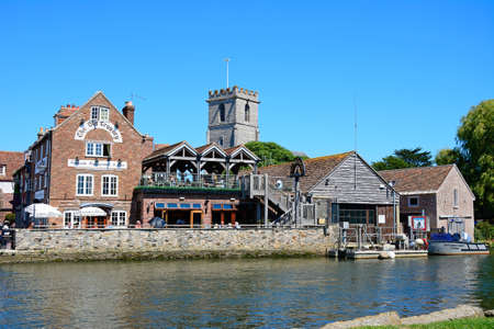 piddle: View across the river towards The Old Granary and Lady St Mary church, Wareham, Dorset, England, UK, Western Europe. Editorial