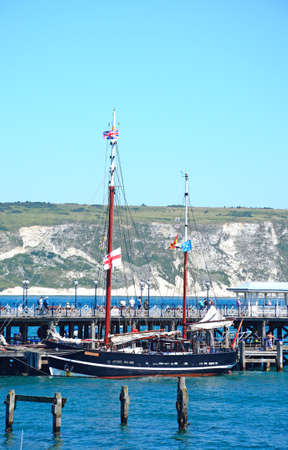 The Moonfleet tallship moored alongside the Victorian pier, Swanage, Dorset, England, UK, Western Europe. Editorial