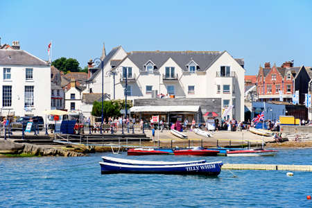 View of boats moored in the bay and the beach and waterfront buildings to the rear, Swanage, Dorset, England, UK, Western Europe.