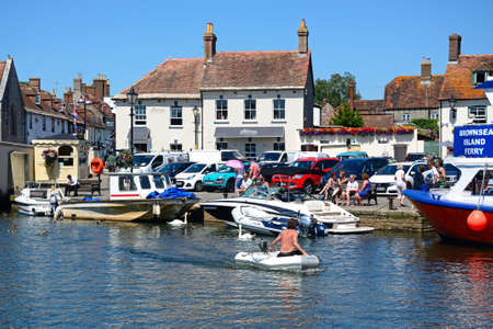 Boats on the river with views towards the town, Wareham, Dorset, England, UK, Western Europe. Editorial