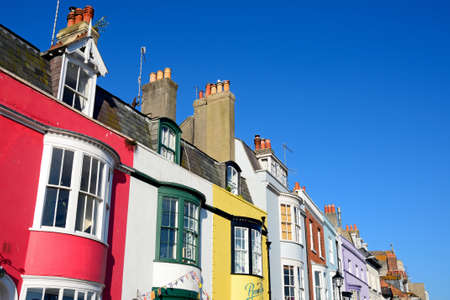 Brightly painted buildings alongside the harbour, Weymouth, Dorset, England, UK, Western Europe.