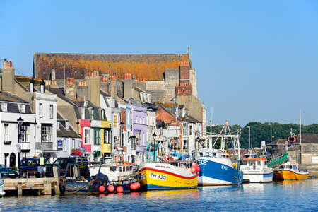 View of fishing boats and quayside buildings in the harbour, Weymouth, Dorset, England, UK, Western Europe.