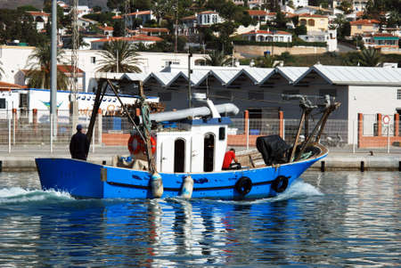 Boats moored in the harbour with apartments to the rear, Caleta de Velez, Malaga Province, Andalusia, Spain, Western Europe. Editorial