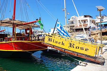 Gangplank leading to the rear of the Black Rose Pirate ship moored in the harbour, Sissi, Crete, Europe.