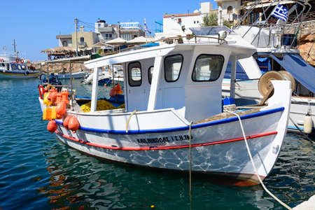 Traditional Greek fishing boat moored in the harbour, Sissi, Crete, Greece, Europe.
