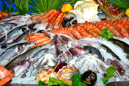 Fresh fish and seafood displayed outside a restaurant, Rethymno, Crete, Greece, Europe.