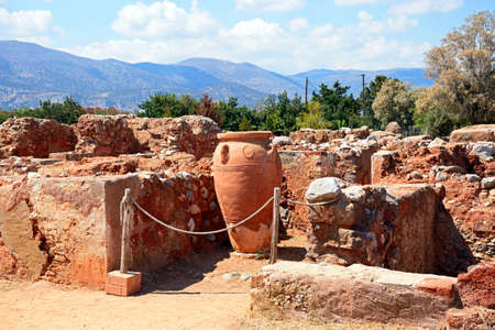 Ancient large decorated terracotta pot within the walls of the Minoan Malia ruins archaeological site, Malia, Crete, Greece, Europe. Stock Photo