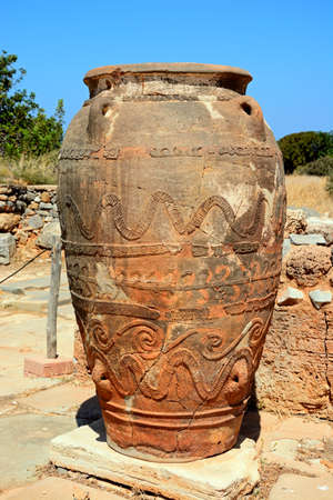 Ancient large decorated terracotta pot at the Minoan Malia ruins archaeological site, Malia, Crete, Greece, Europe.