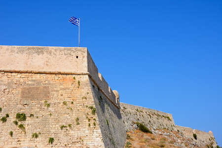 fortezza: View of the Venetian castle walls with a Greek flag on top, Rethymno, Crete, Greece, Europe.