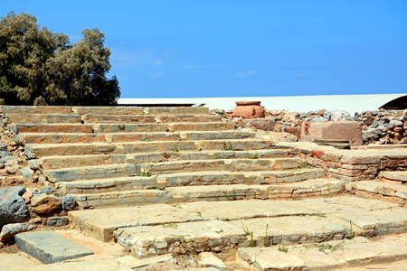 minoan: Wide steps to one of the buildings within the Minoan Malia ruins archaeological site, Malia, Crete, Greece, Europe. Stock Photo