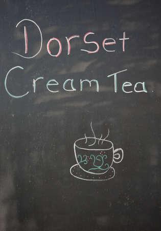 writing western: Dorset cream tea chalkboard, Weymouth, Dorset, England, UK, Western Europe. Stock Photo