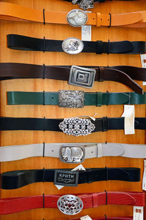 Leather belts with decorative buckles for sale in the old town, Rethymno, Crete, Greece, Europe. Editorial