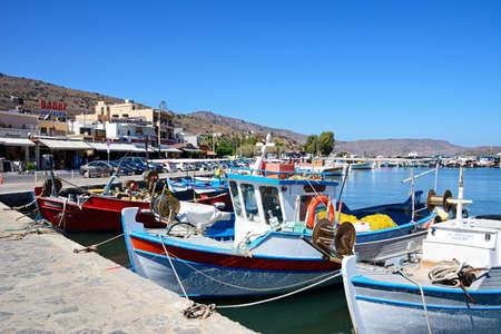 Traditional fishing boats in the harbour, Elounda, Crete, Greece, Europe.