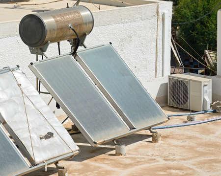 Water heating solar panels on a building roof, Makrigialos, Crete, Greece, Europe.