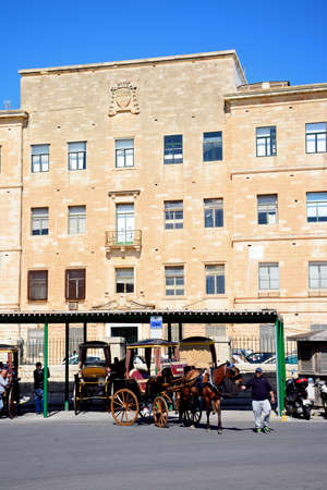 registry: Horse drawn carriages in front of the Public Registry building, Valletta, Malta, Europe.
