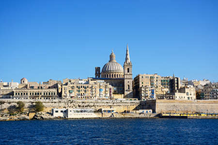 st pauls: View of St Pauls Anglican Cathedral and the Basilica of Our Lady of Mount Carmel seen from the Grand Harbour, Valletta, Malta, Europe.