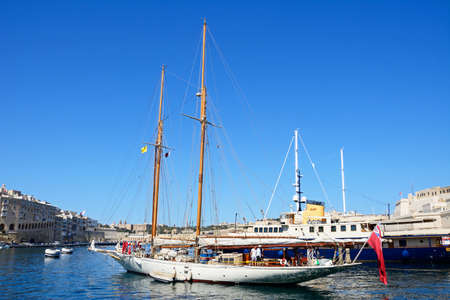 View of yachts moored in the marina with views towards Senglea to the left and Valletta to the rear, Vittoriosa, Malta, Europe. Editorial