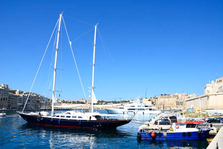 View of yachts moored in the marina with views towards Senglea to the left, Vittoriosa to the right and Valletta to the rear, Vittoriosa, Malta, Europe.