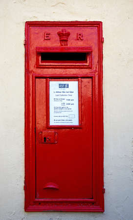 rectangle: Traditional red British postbox in a wall, Mdina, Malta, Europe. Editorial
