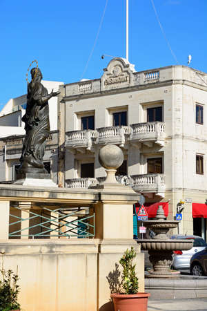 Statue In Front Of The Mosta Dome With Businesses And The Old