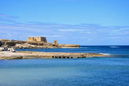 View along the rugged coastline towards the Il-Qolla I-Badja battery, Redoubt, Marsalforn, Gozo, Malta, Europe. Editorial