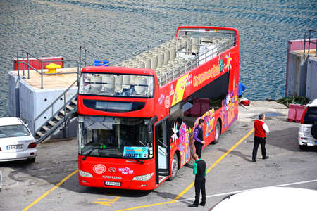 Elevated view of a Gozo city sightseeing tour bus, Mgarr, Gozo, Malta, Europe. Editorial