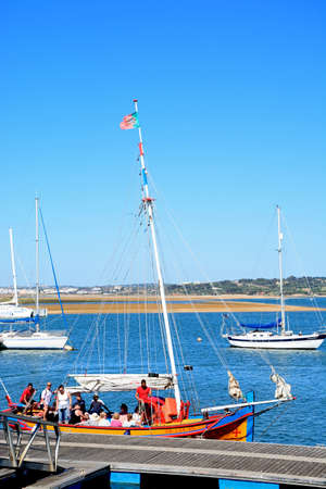 Tourists aboard a wooden tour yacht on the estuary, Alvor, Algarve, Portugal, Europe.