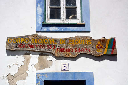Scouts sign on the front of a building, Monchique, Algarve, Portugal, Europe.