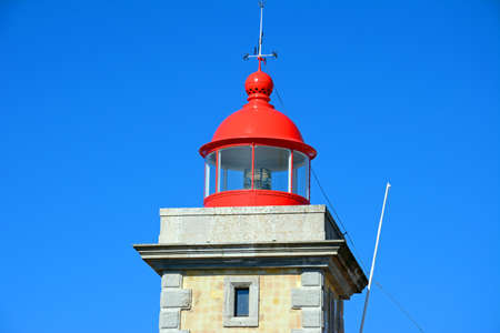 Top part of the lighthouse with its red painted top, Ponta da Piedade, Algarve, Portugal, Europe.