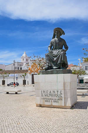 Statue of Infante Dom Henrique (Prince Henry) in the town square with town buildings to the rear, Lagos, Algarve, Portugal, Europe.