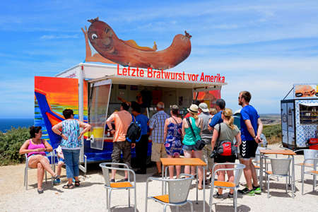 Tourists queuing at a German Bratwurst snack stall, Cape St Vincent, Algarve, Portugal, Europe. Editorial