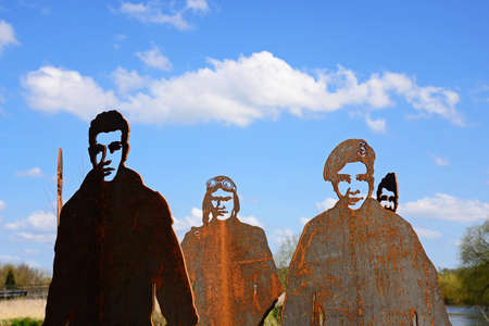 RAF 47 Squadron with cut out faces against a blue sky, National Memorial Arboretum, Alrewas, Staffordshire, England, UK, Western Europe. Editorial