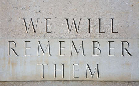 We will remember then stone inscription on the cenotaph within the Armed Forces Memorial, National Memorial Arboretum, Alrewas, Staffordshire, England, UK, Western Europe.
