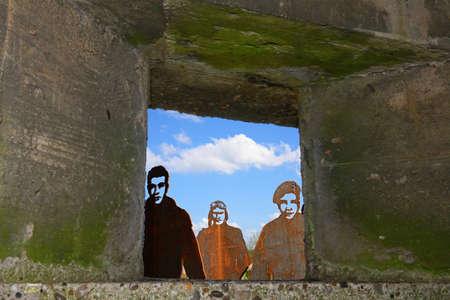 Metal soldiers seen through a bunker window, National Memorial Arboretum, Alrewas, Staffordshire, England, UK, Western Europe. Editorial