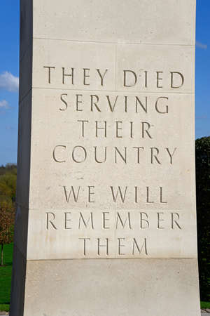 They died serving their country, we will remember them inscription on the cenotaph within the Armed Forces Memorial, National Memorial Arboretum, Alrewas, Staffordshire, England, UK, Western Europe.