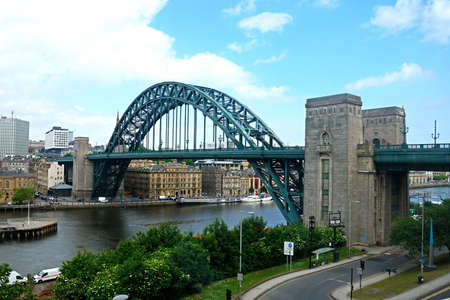 View of the Tyne Bridge across the River Tyne with city buildings to the rear seen from the Gateshead side of the river, Newcastle upon Tyne, Tyne and Wear, England, UK, Western Europe.