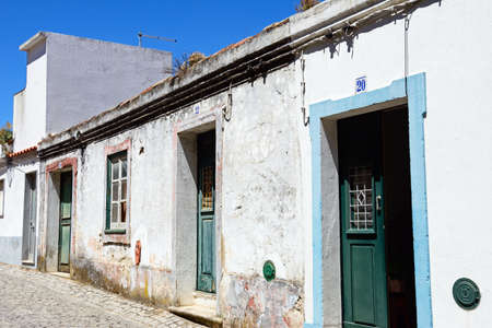 Traditional Portuguese buildings along a street in the old town, Monchique, Algarve, Portugal, Europe. Stok Fotoğraf