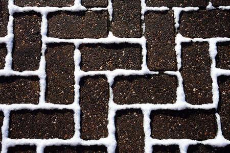 Block paving with snow between the bricks, England, UK, Western Europe.