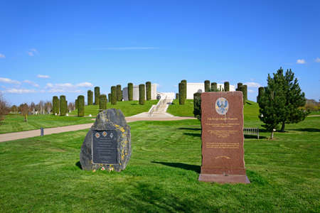 Road and steps leading to the front of the Armed Forces Memorial with The Royal Dragoon Guards and The Kings Royal Hussars monuments in the foreground, National Memorial Arboretum, Alrewas, Staffordshire, England, UK, Western Europe.